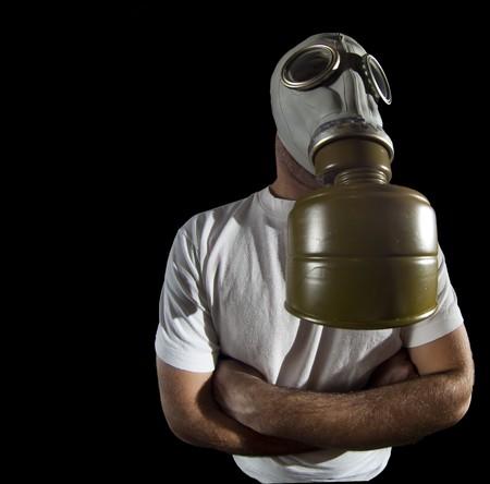 a man wearing a gas mask environment danger concept image