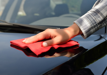 Photo for Car care - Polishing a black car - Royalty Free Image