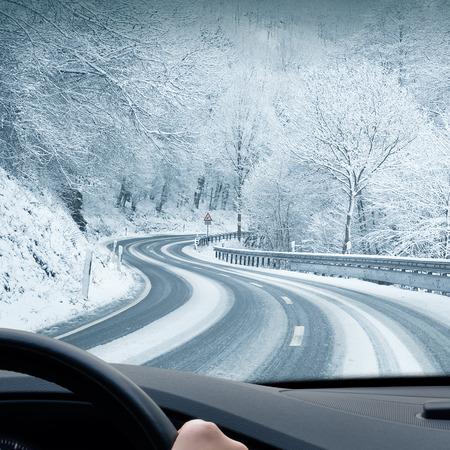 Photo pour Winter Driving - Curvy Snowy Country Road - image libre de droit