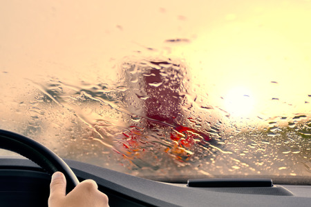 Photo pour Driving on a Highway at Sunset When it starts to rain - image libre de droit