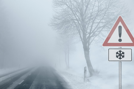 Photo for Caution - Foggy Winter Road - Royalty Free Image