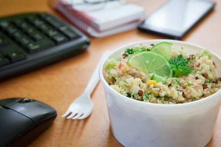 Foto de Healthy Vegetable Lunch Box On Working Desk - Imagen libre de derechos
