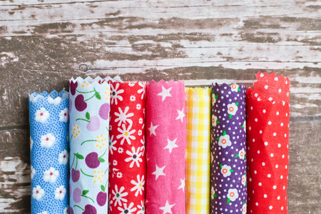 Photo pour Rolls of colorful patterned fabric - image libre de droit