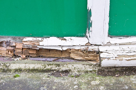 Photo pour Close up of part of a wooden window frame showing extensive rot - image libre de droit