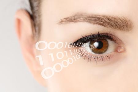 Foto de Close-up of eye of woman with binary code - Imagen libre de derechos
