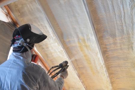 Foto de Polyurea Spraying, warming foam coating of roof. - Imagen libre de derechos