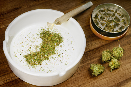 Photo pour Crumbled weed in the shape of Oman and a joint. - image libre de droit
