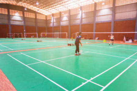 Photo for blurred background badminton players on green court - Royalty Free Image