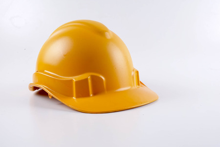 Foto de Yellow hardhat safety helmet on white background - Imagen libre de derechos
