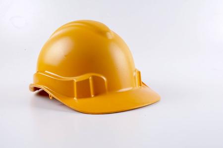 Photo pour Yellow hardhat safety helmet on white background - image libre de droit
