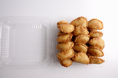 Photo for Curry Puffs (Epok-Epok / Karipap Pusing) - Deep Fried Malaysian, Singaporean, and Thai snack filled with curried meat and/or vegetables. - Royalty Free Image