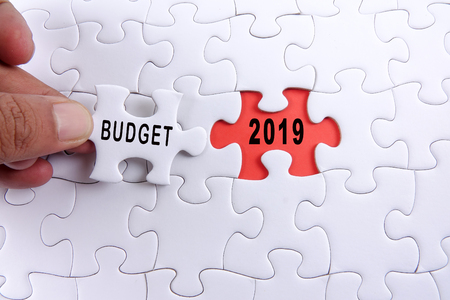 Photo pour Business concept: 2019 BUDGET word on a jigsaw puzzle background. - image libre de droit