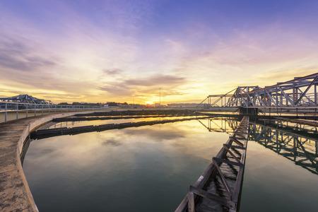 Foto de sewage treatment plant with sunrise - Imagen libre de derechos
