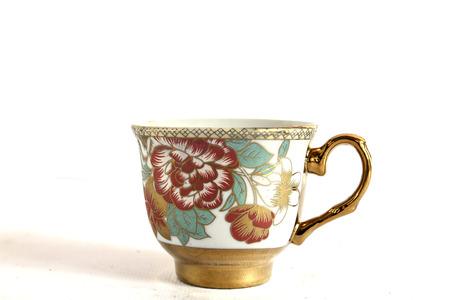 Foto de Elegant Antique china tea cup and saucer on white background - Imagen libre de derechos