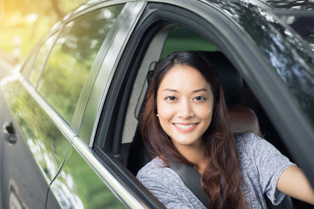 Photo pour Beautiful Asian woman smiling and enjoying.driving a car on road for travel - image libre de droit
