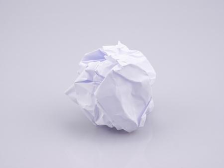 Foto de Crumpled paper balls on agray background - Imagen libre de derechos