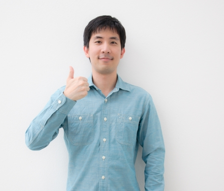 Photo for portrait of an asian man thumb up - Royalty Free Image