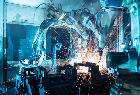 Photo for Team welding robots represent the movement. In the automotive parts industry. - Royalty Free Image