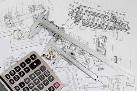 Photo for Engineering drawings & measuring instrument - Vernier caliper, coursework or thesis project. Project engineer. - Royalty Free Image