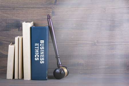 Photo for Business Ethics. Wooden gavel and books in background. Law and justice concept. - Royalty Free Image