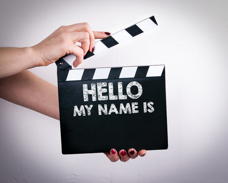 Photo for Hello My Name Is. Female hands holding movie clapper. - Royalty Free Image