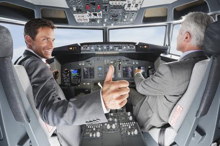 Photo pour Pilot and co-pilot piloting airplane from airplane cockpit - image libre de droit