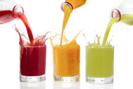 Photo pour Fruit juices poured from bottles Kiwi, currants, orange - image libre de droit
