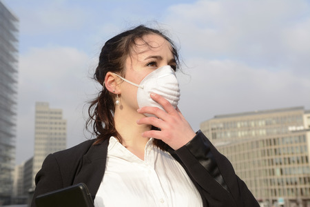 Photo for Business woman wearing protective mask against pollution, Berlin, Germany - Royalty Free Image