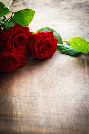 Photo for Red roses on wooden background - Royalty Free Image