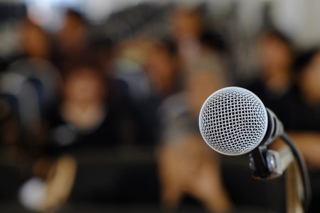 Photo for Silver microphone on the podium for those who will be the speakers at the conference. - Royalty Free Image