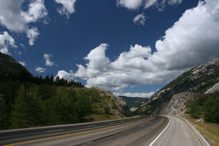 Crowsnest Pass on Crowsnest Highway - beautiful landscape and empty road.