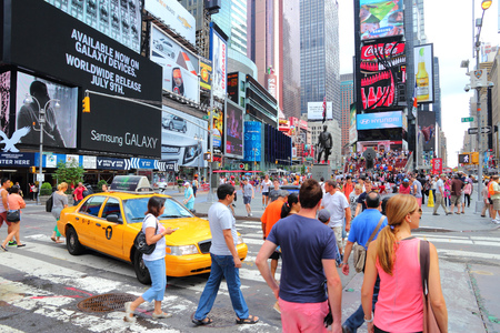 Foto für NEW YORK, USA - JULY 4, 2013: People visit Times Square in New York. Times Square is one of most recognized landmarks in the world. More than 300,000 people pass through Times Square daily. - Lizenzfreies Bild