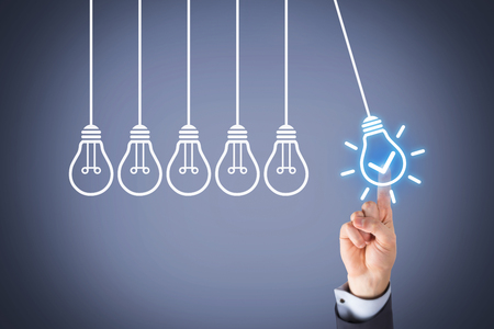 Photo for Idea Concepts Light Bulb on Touch Screen - Royalty Free Image