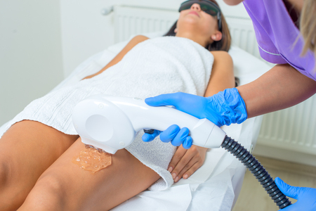 Photo for Young beautiful woman gets professional body shape treatment in a beauty clinic - Royalty Free Image