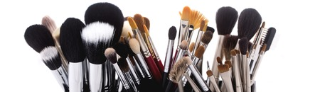 Photo for Different professional natural soft make-up brushes for eyeshadow powder and facial foundation for visagistes black and brown colors on white background, horizontal picture - Royalty Free Image