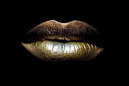 Photo for Closeup view of sexual beautiful female closed golden lips isolated on black background, horizontal picture - Royalty Free Image