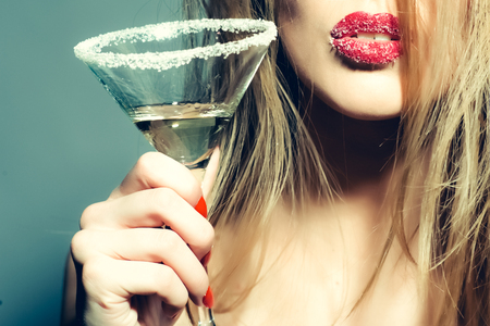 Photo for Beautiful woman? pretty sexy lady holding glass of tasty alcohol martini in her hand - Royalty Free Image