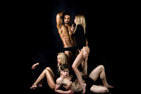 Photo pour couple in love, man with bare chest near group of people of guy and women in love relations on black background, lesbian and gay, betrayal - image libre de droit