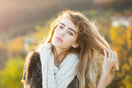 Foto de Fashion model with pretty face. Girl on autumn natural background. Season and fall holiday. Beauty and fashion. Woman with long hair and natural makeup. - Imagen libre de derechos