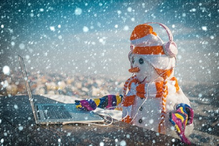 Foto de christmas new year snow concept Xmas or christmas decoration, audio book. Snowman in winter with laptop, headset and tea cup. Christmas and hot wine. Happy holiday celebration new technology. New year - Imagen libre de derechos