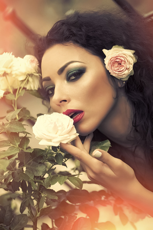 Photo for Portrait of adorable woman with rose in hair - Royalty Free Image