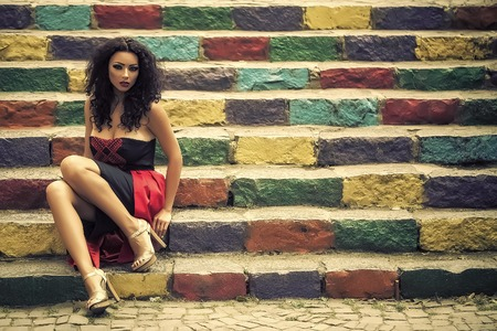 Photo pour Young woman on stairs - image libre de droit
