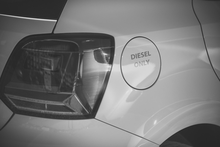 Foto de Petrol tank white car with inscription only diesel. Fuel and refueling concept. Fuel tank cap, car body, headlight, rear view. Vehicle must refueling only with diesel - Imagen libre de derechos