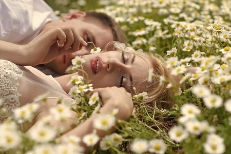 Photo pour Couple secrets fantasy. Couple in camomiles - image libre de droit