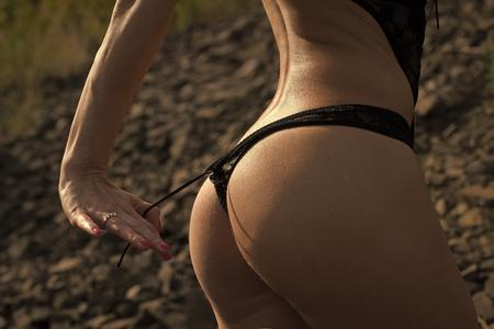 Photo pour Sensual sexy woman. Womans buttocks in panties - image libre de droit