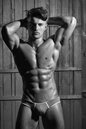 Photo for Mens heals care. Gorgeous young sexy muscular bodybuilder - Royalty Free Image