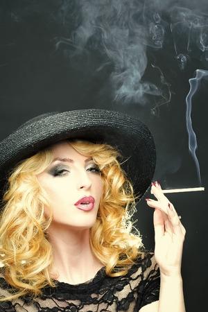 Photo for Smoking retro woman - Royalty Free Image