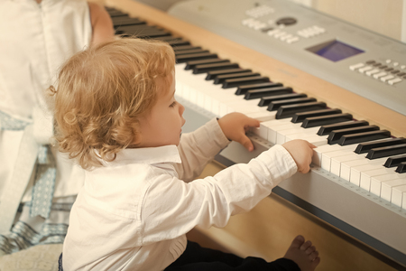 Photo pour young genius virtuoso. Boy play on digital piano - image libre de droit