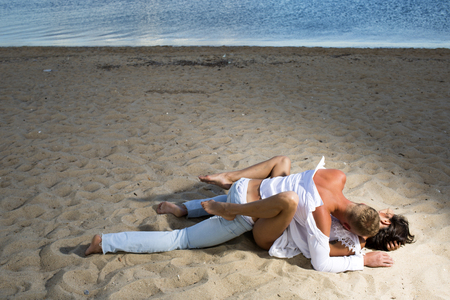 Foto de Family and valentines day. Summer holidays and paradise travel vacation. Sexy woman and man have sex games. Couple in love with sexy body relax on beach sand. Love relations of naked couple at sea. - Imagen libre de derechos