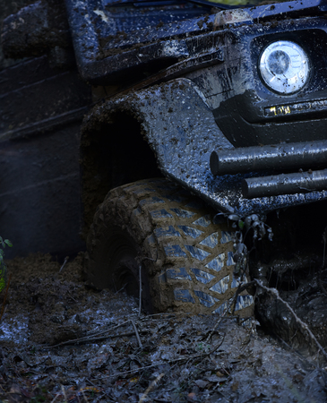 Foto per Extreme entertainment concept. Offroad tire covered with mud - Immagine Royalty Free